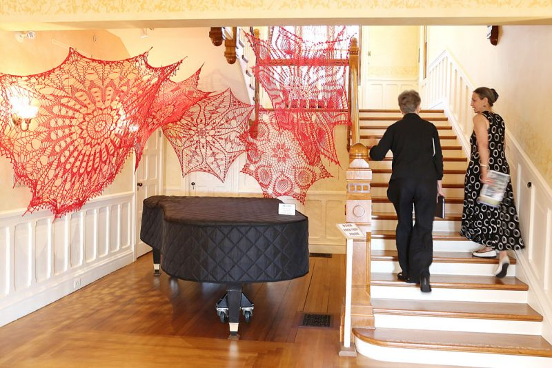 Grand Staircase with piano and art installation