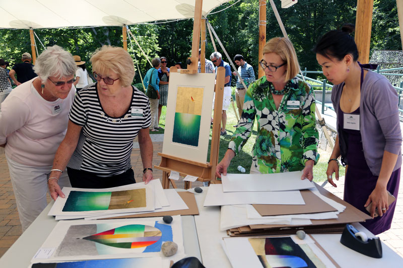 Print sale and demonstration on tent patio